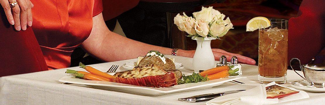 Casino player enjoying gameside dining at Barona Resort & Casino